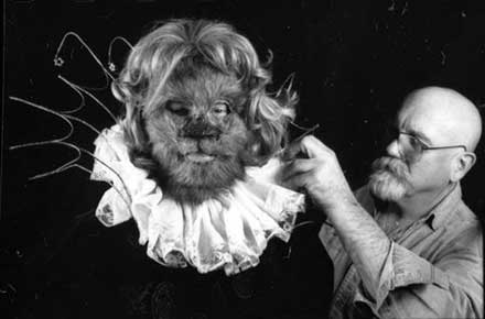Eugene Hare puts the finishing touches on The Beast, played by Wayne Schaeffer.