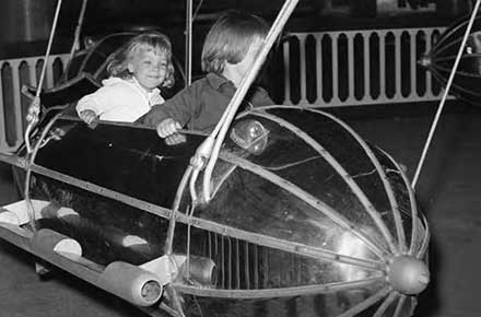 Two young Green Thumb Club members on the kiddie rocket ride, 1964
