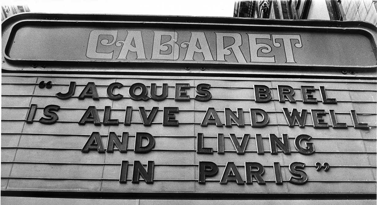 Cabaret Theater's marquee for Jacques Brel is Alive and Well and Living in Paris, 1975.