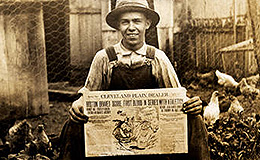 Man holding the Cleveland Plain Dealer from October 1914