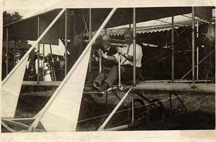 A.I. Root at the Medina County Fair in a Wright brothers airplane, 1915