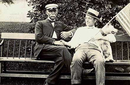 Two unidentified men on a bench