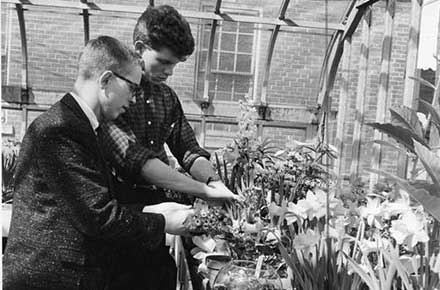 Peter Wotowiec with a student at West Technical High School greenhouse
